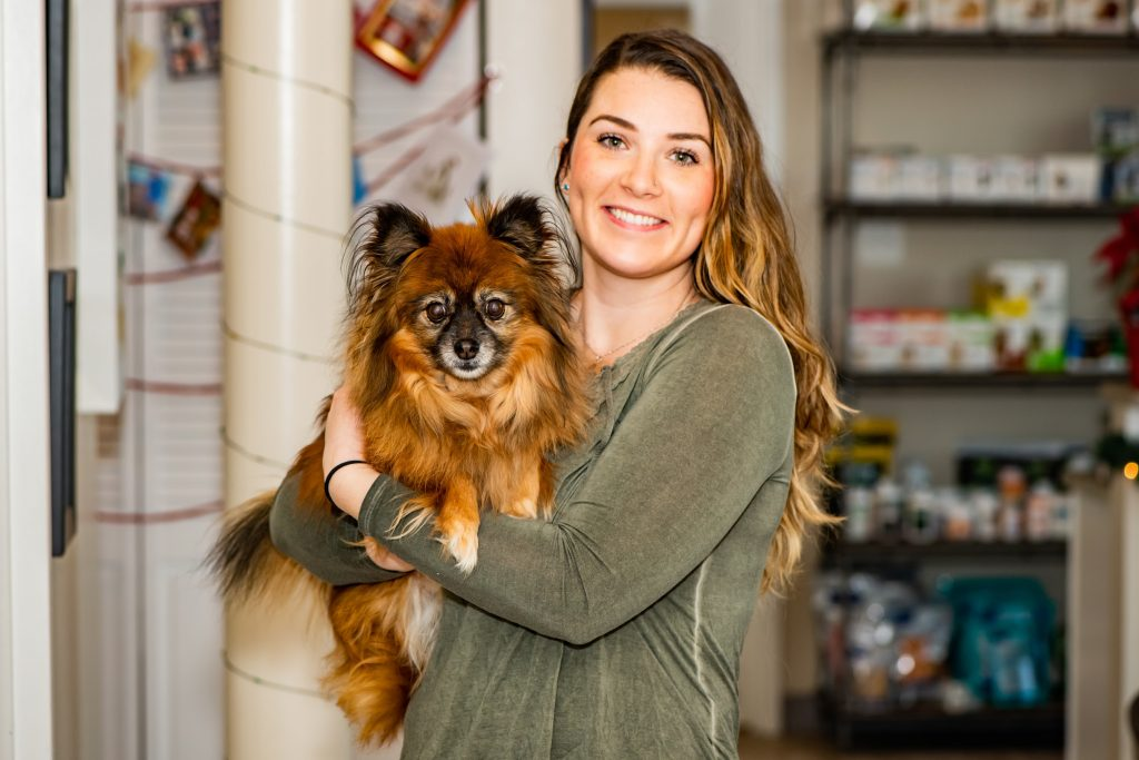 Woman holding brown dog