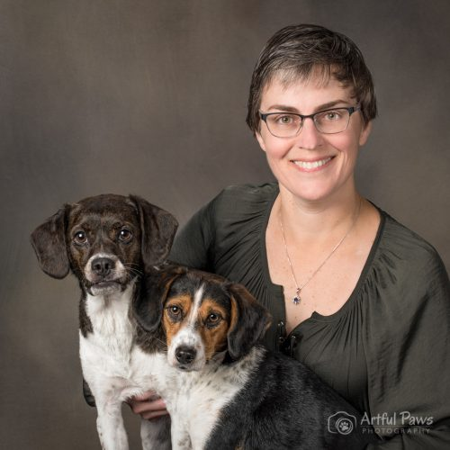 female in green blouse with two beagle mixes
